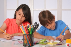 Young brother ands sister doing homework